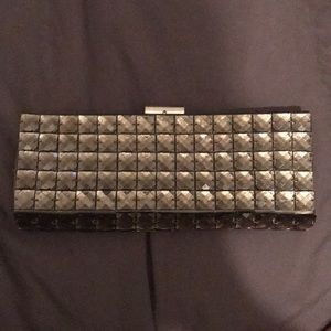 Clutch with metallic shimmer